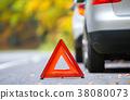 Broken car concept, breakdown triangle on road 38080073