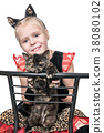 Cats on a chair 38080102