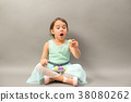excited little girl with a plate full of macaroons 38080262