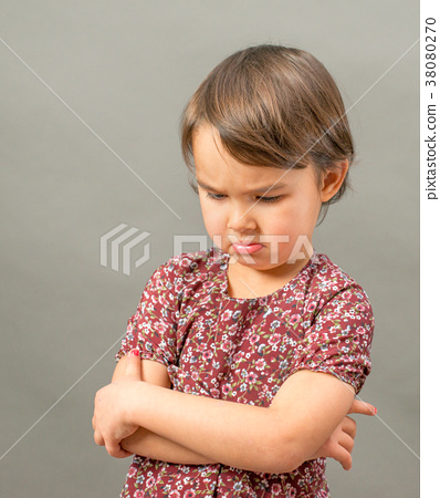 angry and sad girl, isolated over gray background 38080270