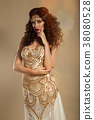 Beautiful girl with long wavy hair and fashion 38080528