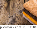 Stack of terry towels on wooden table 38081184
