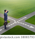 Young businessman at crossroads in uncertainty 38083793
