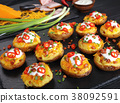 potatoes loaded with cheese, bacon, cream 38092591