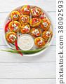 baked potato halves on white plate 38092593