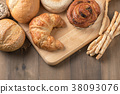 Homemade croissant and bread on old wood 38093076