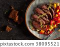 Grilled steak and vegetables. 38095521