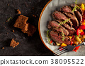 Grilled steak and vegetables. 38095522