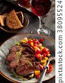 Grilled steak and vegetables. 38095524