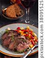 Grilled steak and vegetables. 38095525