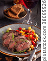 Grilled steak and vegetables. 38095526