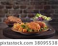 Grilled steak and vegetables. 38095538