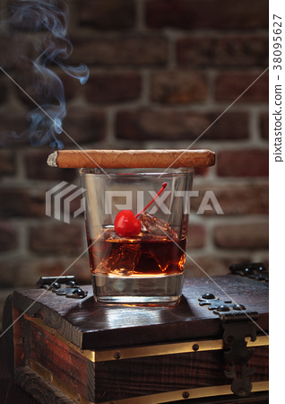 Whisky and cigar. 38095627