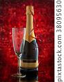 Champagne and Christmas lights. 38095630