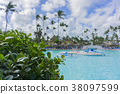 Beach chairs in swimming pool at tropical hotel 38097599