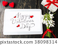 Happy Valentines day calligraphy note on a tablet 38098314
