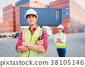 Asian foreman control loading Containers and staff 38105146