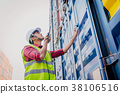 Asian foreman checking containers box for Logistic 38106516