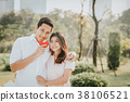 Happy smiling Asian couple in love embracing 38106521