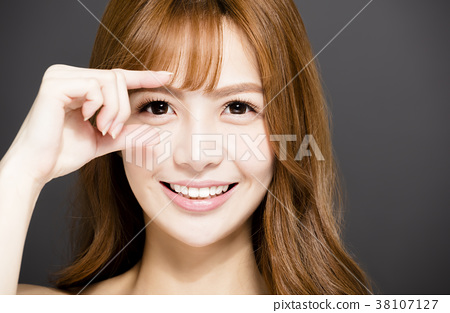 closeup young woman face with beautiful eyes 38107127