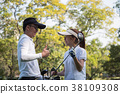 Asian young couple playing golf on golf course 38109308
