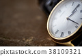 Close up front view of a modern wrist watch  38109321