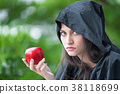 Young beautiful woman with red apple. 38118699