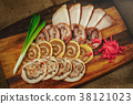 sliced delicious meat rolls on a wooden  38121023