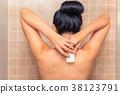 Portrait of beautiful woman using a soap  38123791