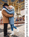 Glad old man and woman enjoying romance in city 38124173