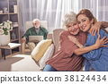 Happy female embracing granny in room 38124434