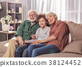 Cheerful grandpa and granny with grandson 38124452