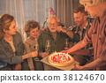 Outgoing relatives congratulate grandpa in room 38124670