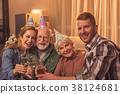 Smiling family celebrating birthday in apartment 38124681