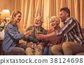 Happy family celebrating birthday in room 38124698