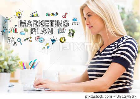 Marketing Plan with happy young woman in front of 38124867