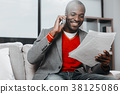 Fashionable happy guy reading notes and 38125086