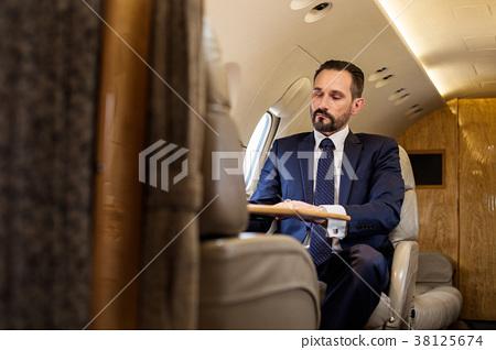 Serene gentleman using private jet 38125674