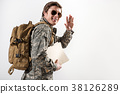 Glad young male soldier waving goodbye 38126289