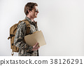 Cheerful military guy walking with smile 38126291