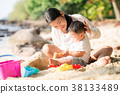 Asian mother and baby play sand and toy togather 38133489