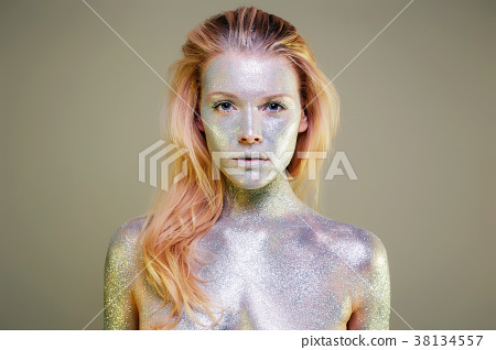 Beautiful Girl with Sparkles on her Face and Body 38134557