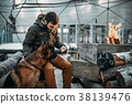 Stalker feeding a dog, apocalypse concept 38139476