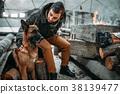 Stalker, post-apocalypse soldier feeding a dog 38139477