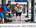 Fat woman training with instructor, hard workout 38139850