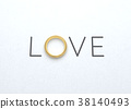 The word love with wedding ring on white paper. 38140493