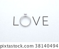 The word love with wedding ring on white paper. 38140494