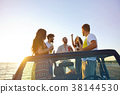 Group of happy friends making party in car - Young 38144530