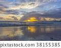 Dramatic sunset over ocean waves. Clouds 38155385