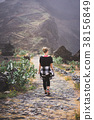 Woman hiker on the picturesque coastal cobbled 38156849